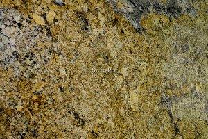 A gold granite with light grey veins of quartz.