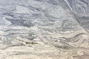 A grey granite with black and light beige veins.