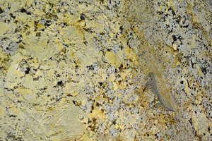 A cream and beige granite with black spots.
