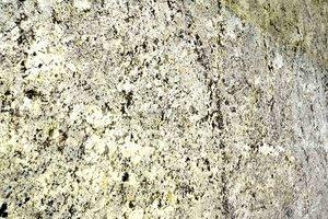 A white and cream granite with some grey quartz.