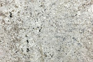 A grey and white granite with brown and black accents