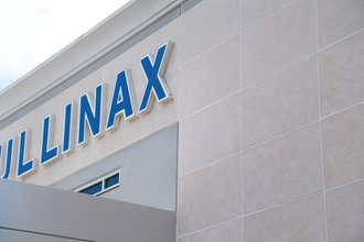 Close up photo of Mullinax Ford signage on exterior Stoneply Panels