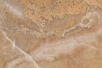 A marble that has a varity of beiges, creams, and pinks with subtle veining.