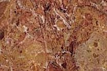 A red marble with brown fragments.